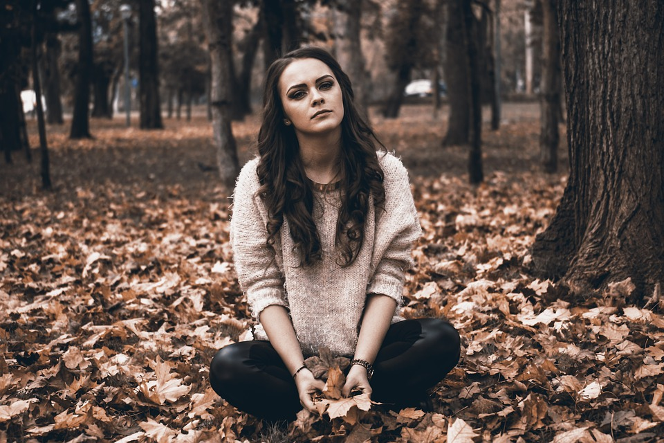 Moore Quote, beautiful young girl sitting on autumn leaves