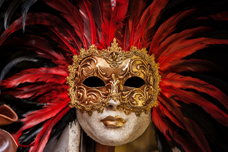 Baker Quote, golden mask and lips with red feathers