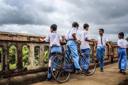 Mitra Quote, group of rural boys in school uniforms on old bridge