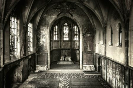 Van Creveld Quote, man leaning against altar in abandoned beautiful chapel