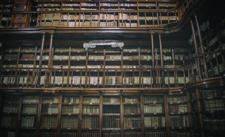 Carlyle Quote, old library shelves filled with encyclopaedic books