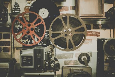 Steinem Quote, really old reel movie projector