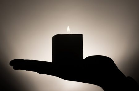 Nietzsche Quote, shadow of burning candle on palm