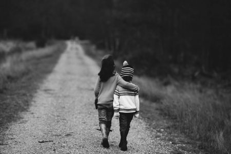 Epictetus Quote, siblings walking in a warm embrace on an empty road