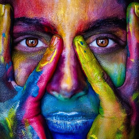 Lowell Quote, woman's face painted in many bright colors