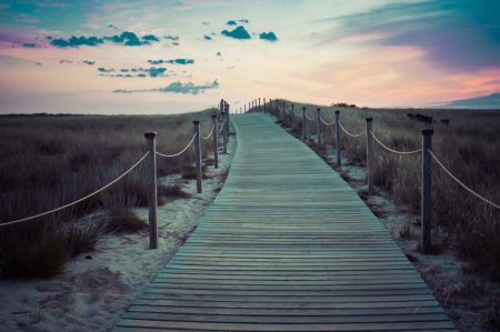 Gandhi Quote, wooden path on dunes at sunset