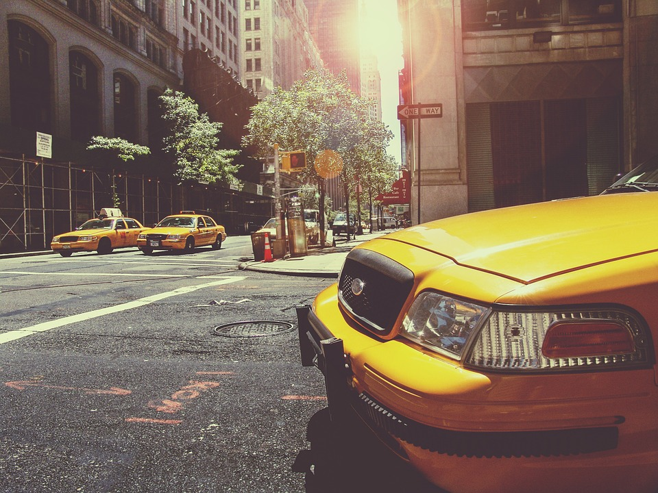 Huntington Quote, yellow taxi parked in New York City