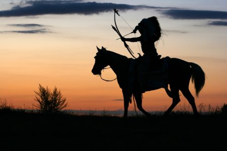 Means Quote, Indian warrior stretching bow and arrow on horse at sunset