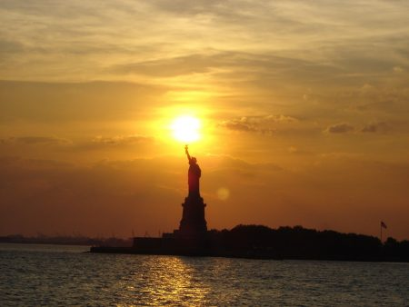 Cioran Quote, sun falling on Statue of Liberty in NYC sunset